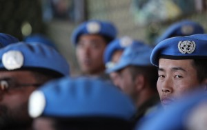 A_Chinese_peacekeeper_attends_a_medal_parade_ceremony_in_Bukavu_South_Kivu_10761340676